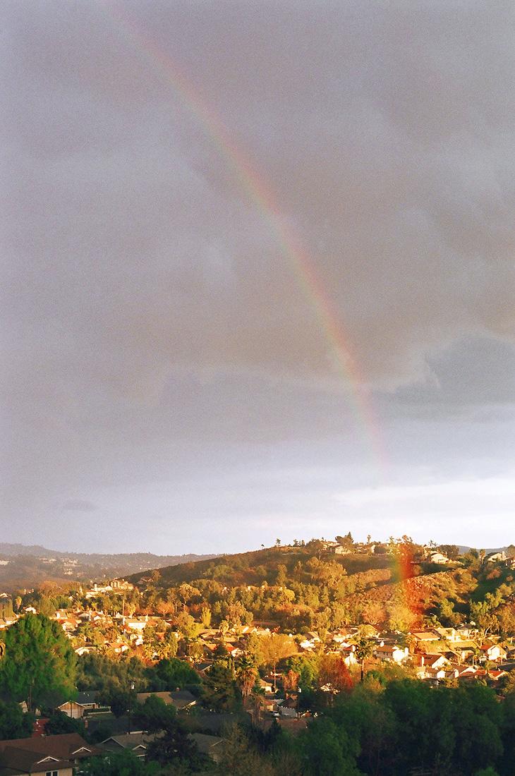 Rainbow falling into a village