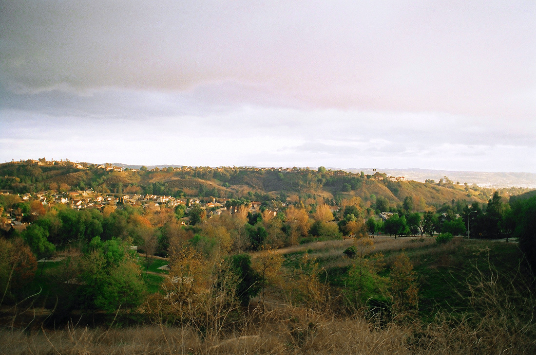 overlooking valley and hills, cloudy sky,