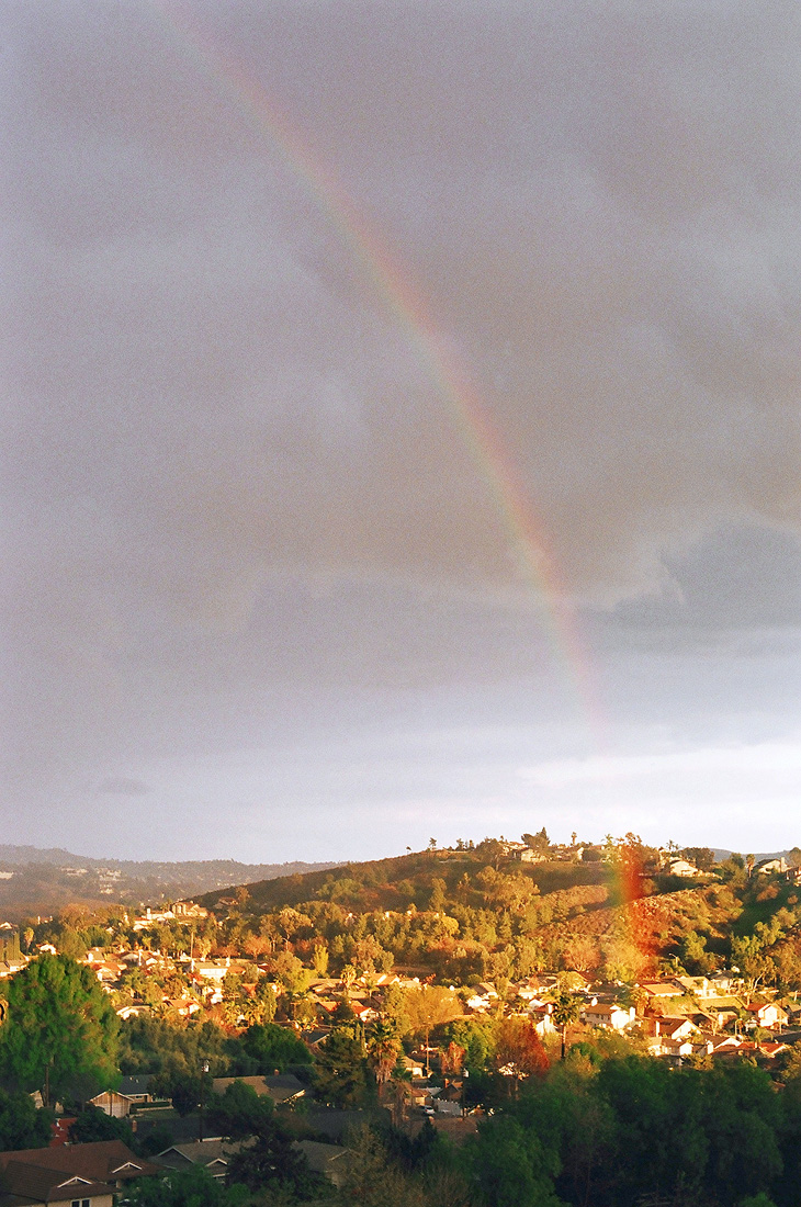 Rainbow falling into a village