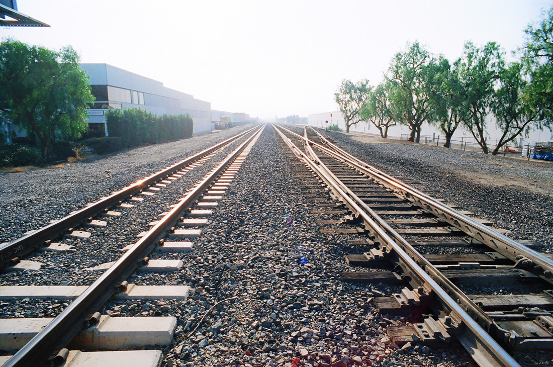 Train tracks vanishing to a point, Rail Road Tracks, Photo taken with an Olympus OM-2, photo taken with a Zuiko Auto-W 21mm f/3.5