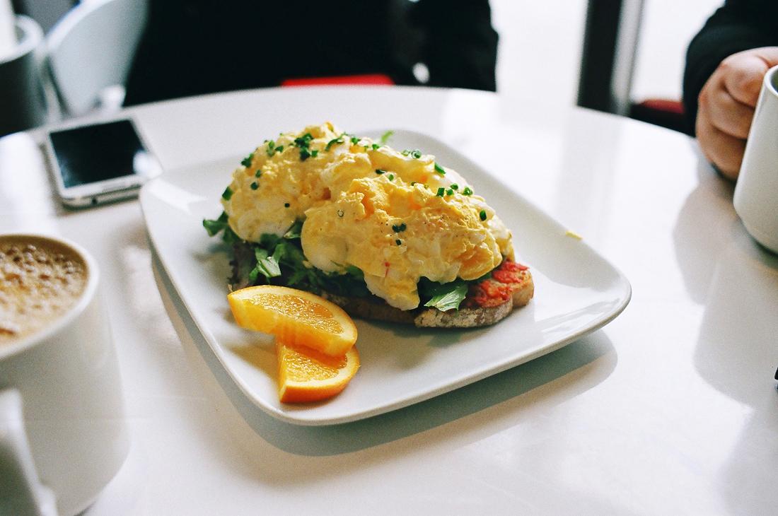 Egg salad sandwich on olive basil bread