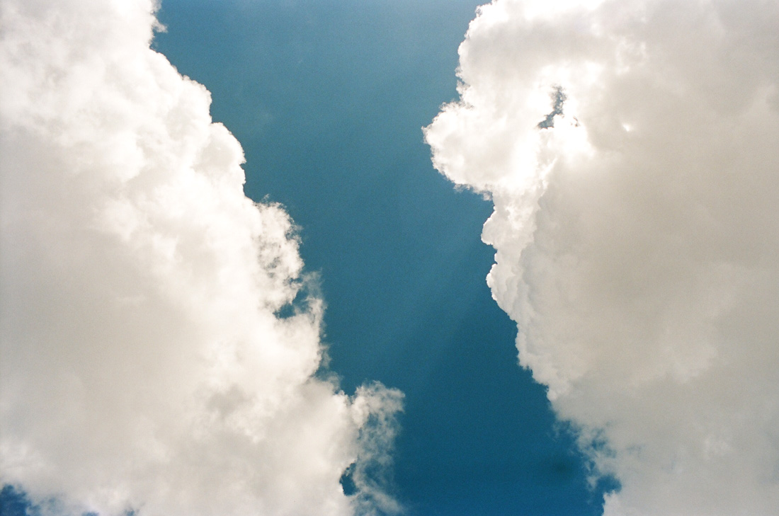 Clouds opening up to the blue sky