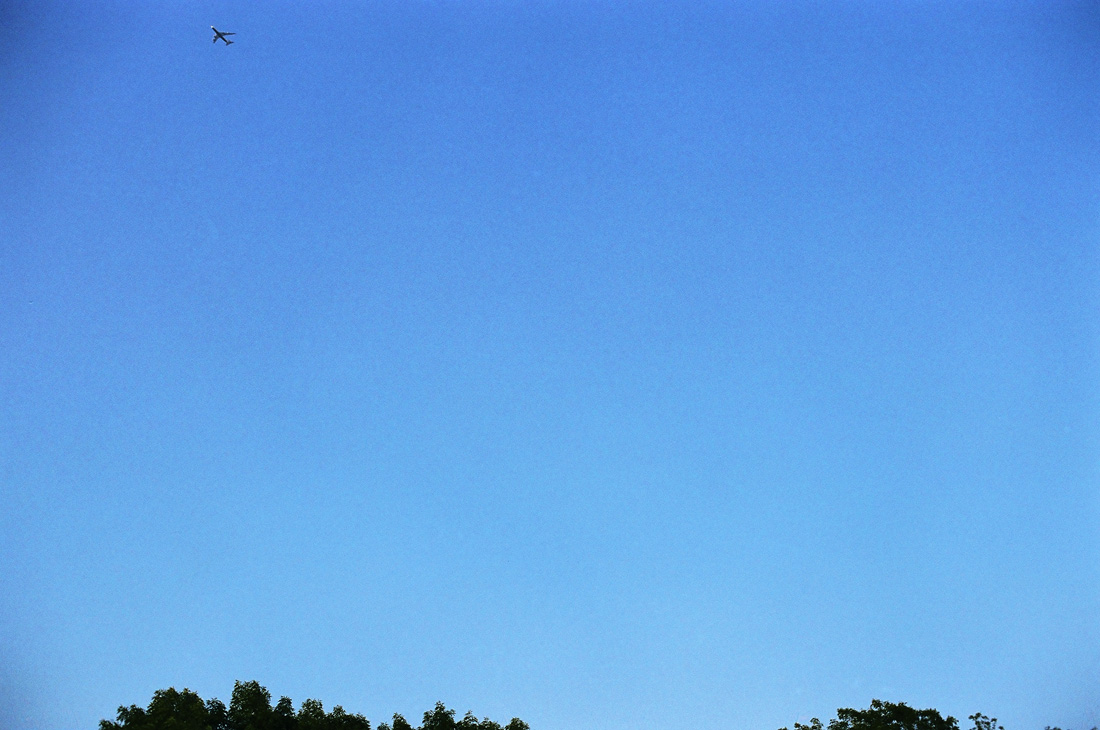 Plane flying in a clear blue sky