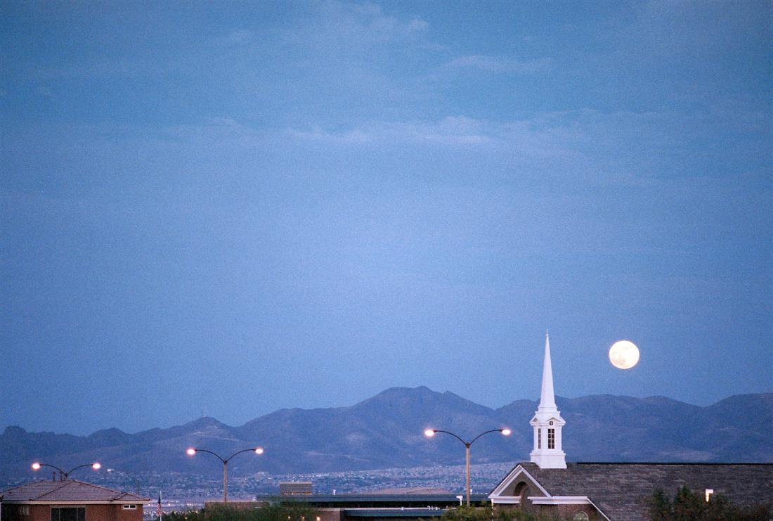 Moon rising behind a church steeple