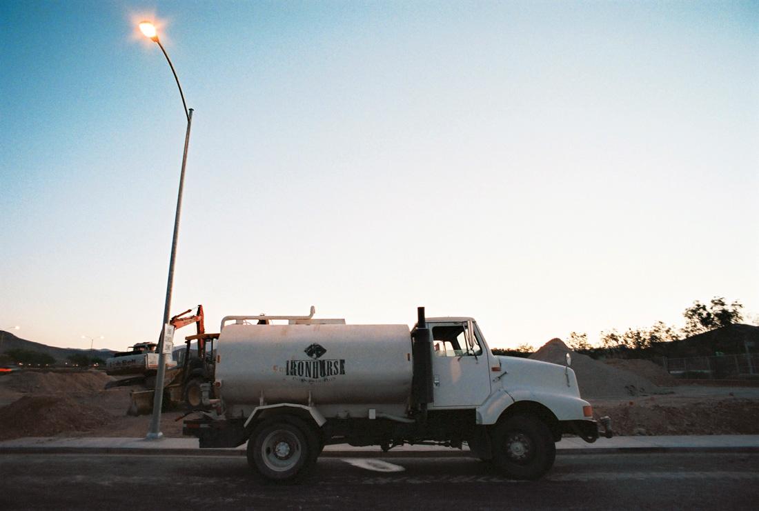 Parked water spraying truck